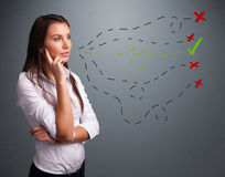 Young woman choosing between right and wrong signs Royalty Free Stock Photos