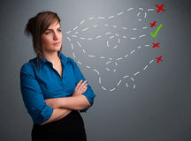 Young woman choosing between right and wrong signs royalty free stock photography