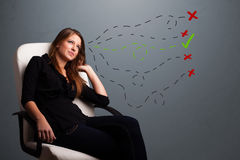 Young woman choosing between right and wrong signs Stock Photo