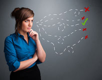 Young woman choosing between right and wrong signs Stock Photography