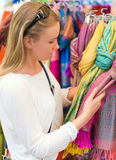 Young woman choosing scarf. Stock Image