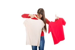 Young woman choosing shirt. Royalty Free Stock Photography