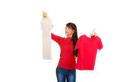 Young woman choosing shirt. Royalty Free Stock Images