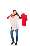 Young woman choosing shirt. Royalty Free Stock Photo
