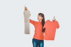 Young woman choosing shirt. Stock Photos