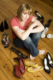 Young woman choosing shoes Royalty Free Stock Photos