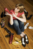 Young woman choosing shoes Stock Photos