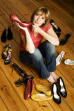 Young woman choosing shoes Stock Image