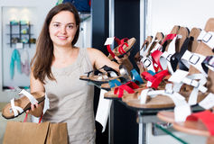 Young woman choosing shoes in store Royalty Free Stock Photo