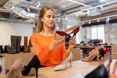 Young woman choosing shoes at store Stock Image
