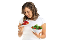 Young woman choosing sweets or healthy eating Stock Image