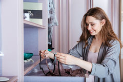 Young woman choosing what lingerie to wear in a closet Stock Images