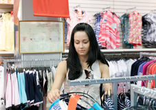 Young woman choosing which dress wear Stock Images