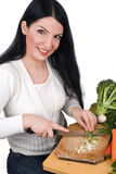 Young woman chopping green onion Royalty Free Stock Image