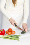 Young Woman Chopping Vegetables Royalty Free Stock Photography