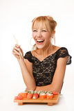Young woman with chopsticks Stock Images