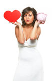 Young woman chosing between love and money Royalty Free Stock Photo