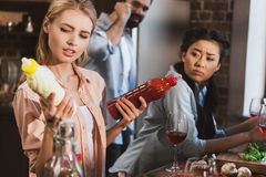 Young woman chosing sauce Royalty Free Stock Images