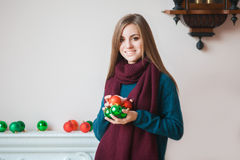 Young woman with christmas ball Stock Photos