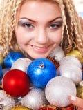 Young woman in christmas balls. Stock Photos