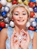 Young woman in christmas balls. Royalty Free Stock Image