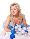 Young woman in christmas balls. Stock Photos