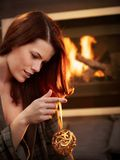 Young woman with christmas bulb Royalty Free Stock Photos