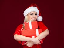 Young woman in Christmas cap Stock Image