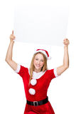 Young Woman with christmas costume showing with placard Royalty Free Stock Images