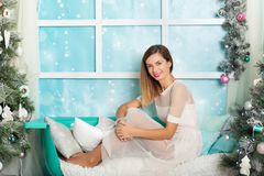 Young woman in a Christmas decorations Royalty Free Stock Photo
