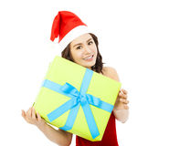 Young woman with christmas gift box over white background Stock Photo