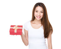 Young woman with christmas gift Stock Photography