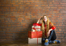Young woman with Christmas gift Stock Photos