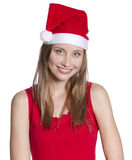 Young Woman with Christmas hat. Beautiful young woman with Christmas hat looking at camera Royalty Free Stock Photography