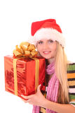 Young woman with christmas hat and gift isolated Stock Photography