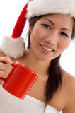 Young woman with christmas hat holding coffee mug Royalty Free Stock Photography