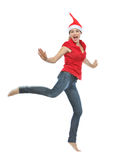 Young woman in Christmas hat jumping Stock Photo