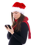 Young woman in Christmas hat keeping GPS Royalty Free Stock Image