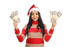 Young woman with a Christmas hat with money bundles stock photo