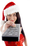 Young woman in christmas hat watching television Stock Photography