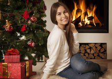 Young woman in Christmas interior Stock Photo