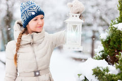 Young woman with Christmas lantern Stock Photography