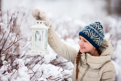 Young woman with Christmas lantern Stock Images