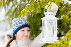 Young woman with Christmas lantern Royalty Free Stock Images