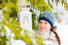 Young woman with Christmas lantern Royalty Free Stock Photography