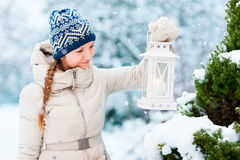 Young woman with Christmas lantern Stock Image