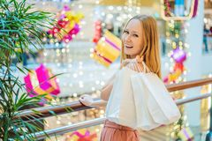 Young woman in Christmas mall with Christmas shopping. Beauty bu stock image