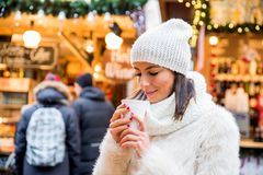 Young woman on the christmas market Stock Photography