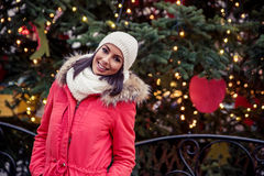 Young woman on the christmas market Royalty Free Stock Photos