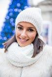Young woman on the christmas market Stock Image